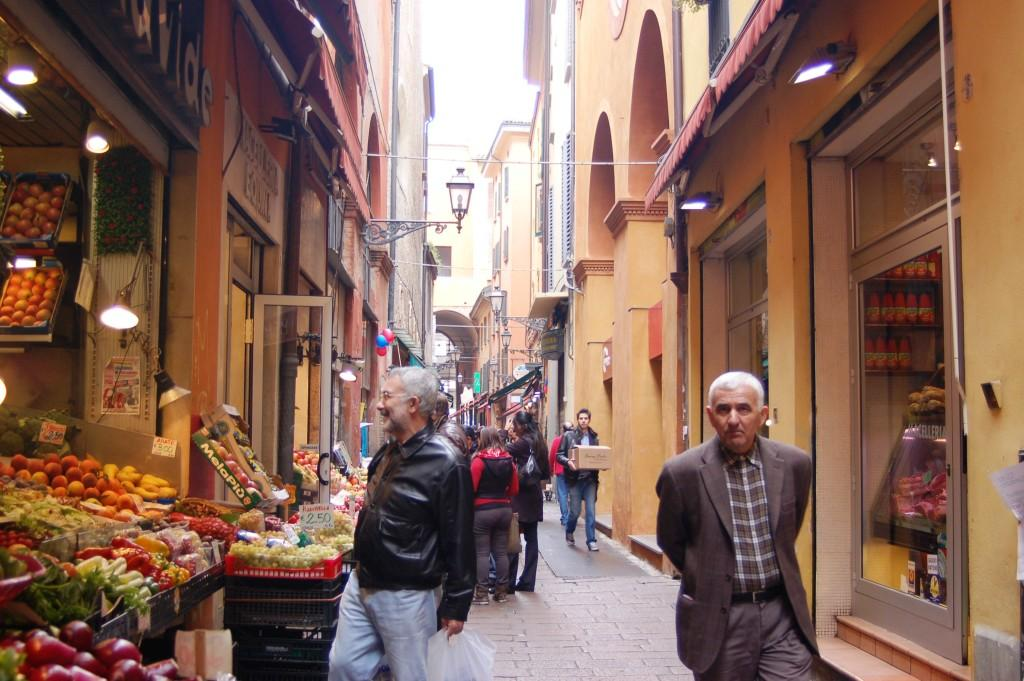 Residents shopping in  Bologna Food Alley, Bologna Italy