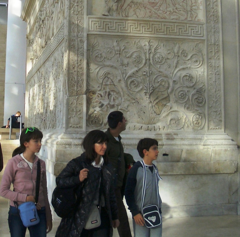 Family touring Ari Pacis Augustan Altar of Peace, Rome Italy